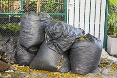 Trash bags. By a city street Royalty Free Stock Photos