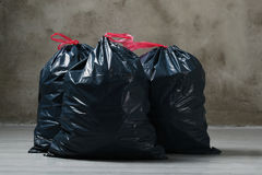 Trash bags. Pollution. Trash bags on the floor royalty free stock photos