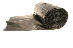 Trash bags rolled up. Isolated photo of trash bags rolled up on white Royalty Free Stock Images