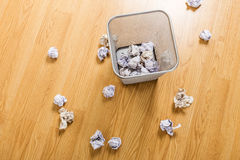 Trash basket and paper ball Royalty Free Stock Images