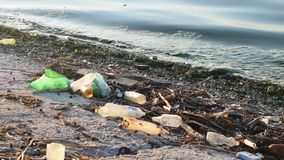 Trash on a beach. With dirty polluted water stock footage