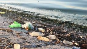 Trash on a beach stock footage