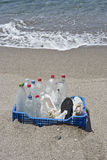Trash in the beach,plastic. A box of trash accumulated on the beach, especially plastics eroded by waves Royalty Free Stock Photo