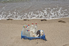 Trash in the beach,plastic. A box of trash accumulated on the beach, especially plastics eroded by waves Stock Image