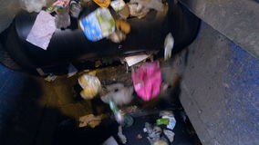 Trash on a belt moving into camera. Close-up. stock video footage