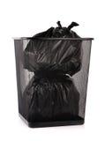 Trash bin. Black garbage bags in trash bin Stock Photos