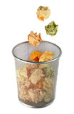 Trash bin. Dropping paper into trash bin Royalty Free Stock Image