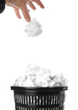 Trash bin. Throwing crumpled paper. Hand and paper with motion blur. Focus on basket Stock Images