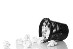 Trash bin. Throwing crumpled paper. Hand and paper with motion blur. Focus on basket Royalty Free Stock Photo