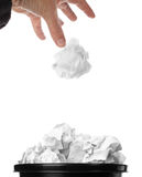 Trash bin. Throwing crumpled paper. Hand and paper with motion blur. Focus on basket Stock Photography