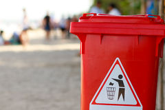 Trash bin on the beach Stock Photos