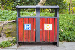 Trash bin both. Trash bins with sorting signs in the park on grass background stock photography