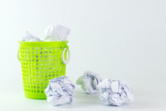 Trash bin and crumpled paper balls Royalty Free Stock Image