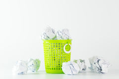 Trash bin and crumpled paper balls Royalty Free Stock Photos