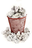 Trash bin is filled with paper waste Royalty Free Stock Image