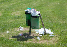 Trash bin full in an outdoor park Royalty Free Stock Images