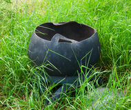 Trash or bin made of tires in wild grass Stock Image
