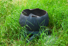 Trash or bin made of tires in wild grass Royalty Free Stock Images