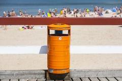 Trash bin near the beach. Littering the beach. Trash bin near the sea beach. Littering the beach and the sea Stock Image
