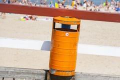 Trash bin near the beach. Littering the beach. Trash bin near the sea beach. Littering the beach and the sea Royalty Free Stock Photos