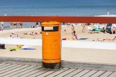 Trash bin near the beach. Littering the beach. Trash bin near the sea beach. Littering the beach and the sea Stock Photo