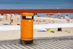 Trash bin near the beach. Littering the beach. Trash bin near the sea beach. Littering the beach and the sea Royalty Free Stock Photo