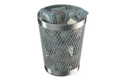 Trash bin with packs of dollars Royalty Free Stock Photography