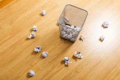 Trash bin and paper ball Stock Photo