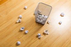 Trash bin and paper ball Stock Photo