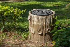 Trash bin In  Park With Tree Trunk Design. Royalty Free Stock Photos