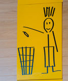 Trash bin sign on the wall. Yellow background Stock Image