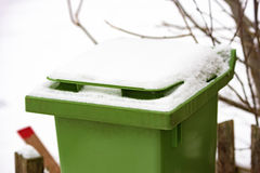 Trash bin with snow Royalty Free Stock Images
