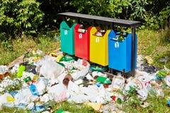 Trash bins and garbage around royalty free stock images