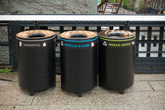 Trash bins in new york. Three trash bins for different types of garbage in the streets of new york Stock Photos