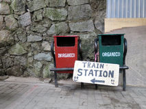 Trash Bins & Train Sign. A pair of trash and recycling bins near the train station in Aquas Calientes stock image