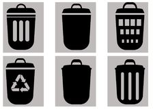 Trash bins vector set. Isolated on grey background. Trash bins vector set with recycle sign. Isolated on grey background Royalty Free Stock Photo