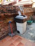Trash brick wall Stock Photo