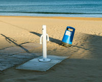 Trash can on the beach close to the shower Stock Photography