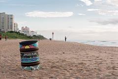 Trash can on the beach near fisherman in Umhlanga Rocks Stock Photography