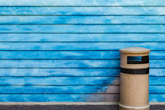 Trash can. On blue wooden wall background Stock Photo