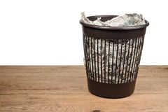 Trash can with crumpled money Stock Photos