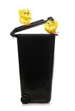 Trash can with easter chicks Stock Image