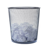 Trash can filled with crumbled paper isolated on white backgroun. Trash can filled with  crumbled paper isolated on white background Royalty Free Stock Photography
