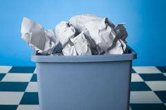Trash can filled with papers Royalty Free Stock Photos
