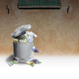 Trash can full of money Royalty Free Stock Images