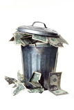 Trash Can Full Of Money Royalty Free Stock Photo