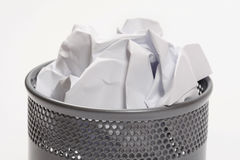 Trash can full of papers stock images