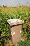 Trash can on a green Royalty Free Stock Photo