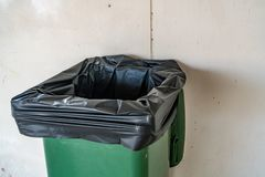 Trash can. Green Trash can on concrete wall background Royalty Free Stock Photo