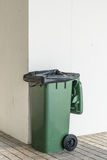 Trash can. Green Trash can on concrete wall background Royalty Free Stock Photography
